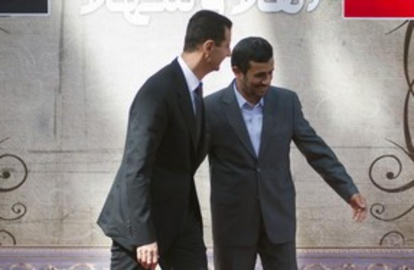 Syrian President Assad, Iranian President Ahmadinejad 311R (photo credit: Morteza Nikoubazl / Reuters)