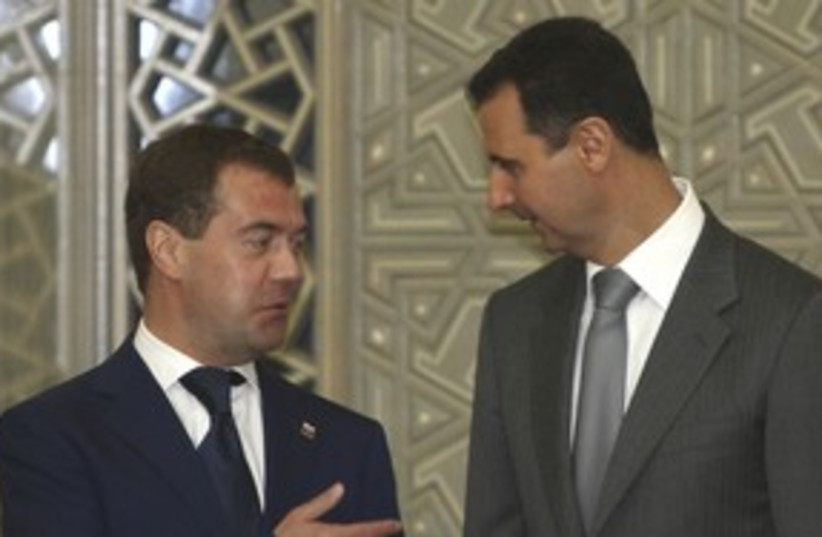 Russian presidident Medvedev with Syria's Assad 311 (R) (photo credit: Khaled Al Hariri / Reuters)