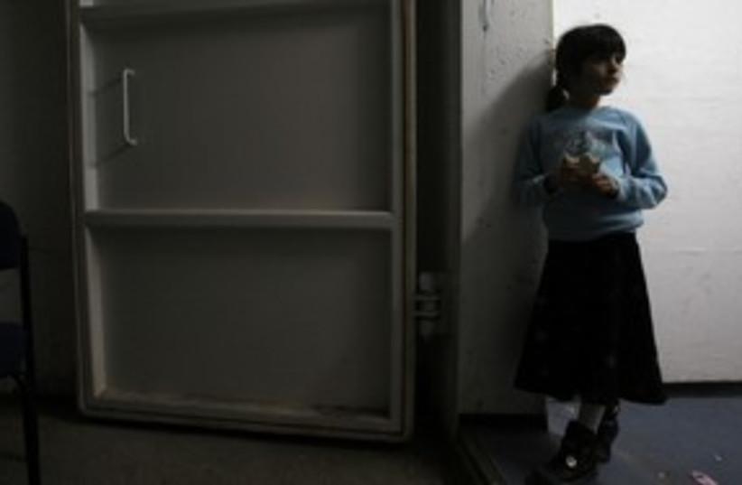 A girl stands inside a bomb shelter in Ashkelon 311 (R) (photo credit: Ronen Zvulun / Reuters)
