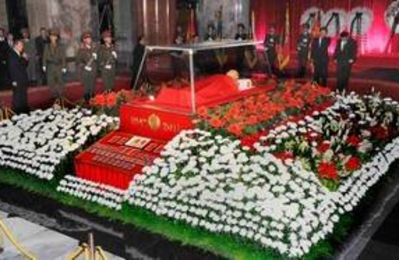 The body Kim Jong-il lies in state in Pyongyang 311 (R) (photo credit: REUTERS/Kyodo)