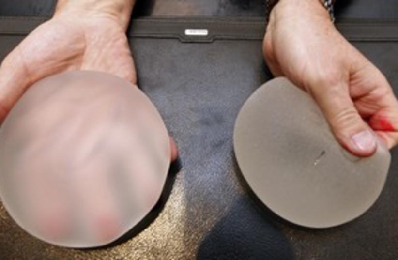 Silicone breast implants 311 R (photo credit: REUTERS/Eric Gaillard)