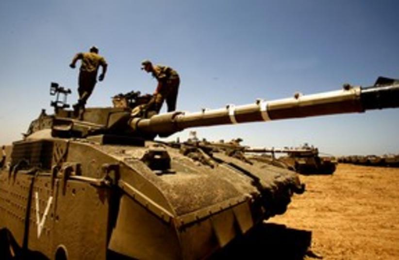 IDF soldiers tank Mefalsim area_311 (photo credit: Reuters)
