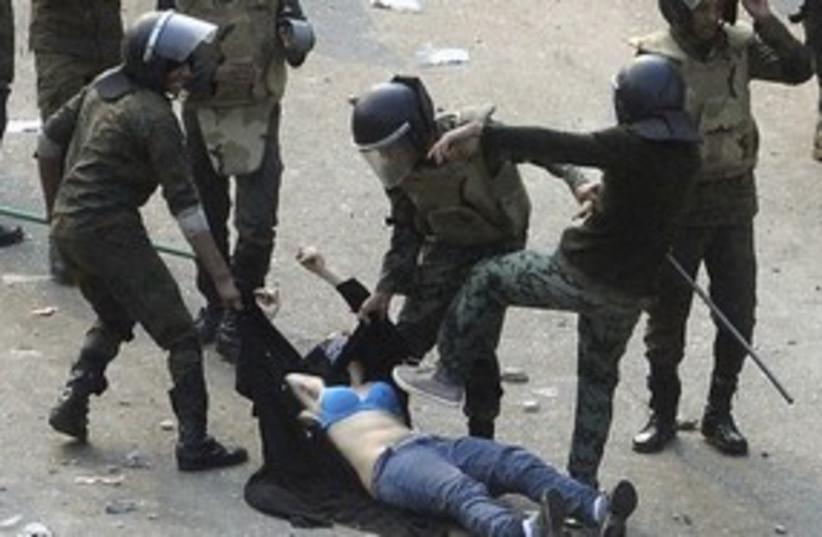 Female protester beaten in Egypt 311 (photo credit: REUTERS/Stringer .)