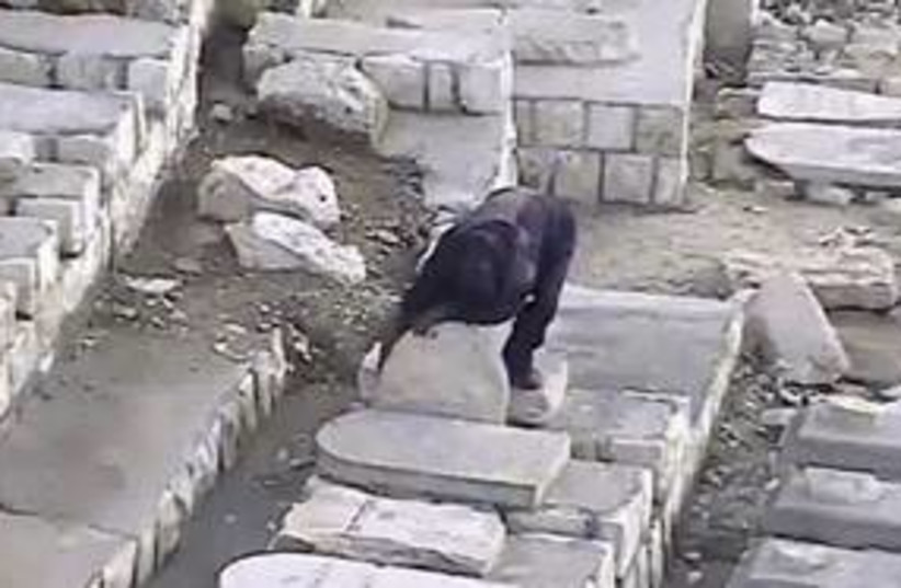 Vandalism at the Mount of Olives 311 (photo credit: Video obtained by the International Committee for )