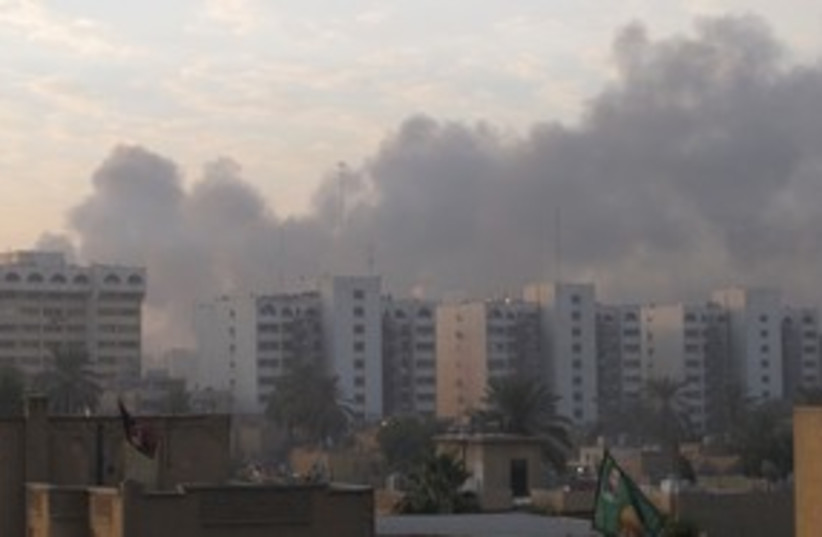 Smoke bomb iraq baghdad 311 (photo credit: REUTERS/Mohammed Ameen )