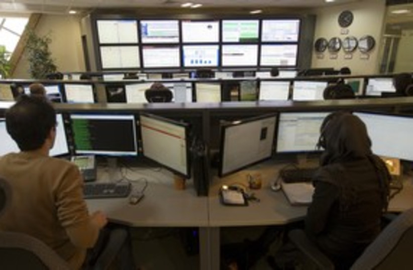 Control room of Internet provider in Iran 311 (R) (photo credit: Caren Firouz / Reuters)
