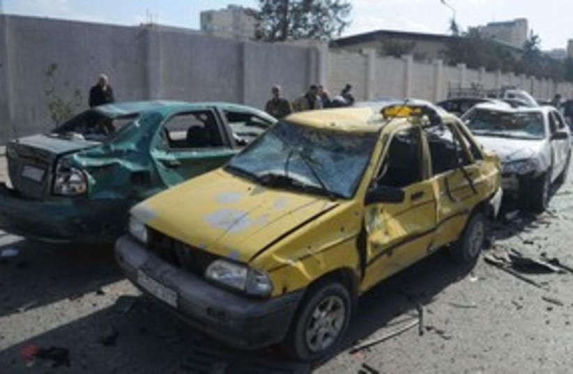 Damaged Syrian cars blast 311 (photo credit: REUTERS/Sana/Handout )