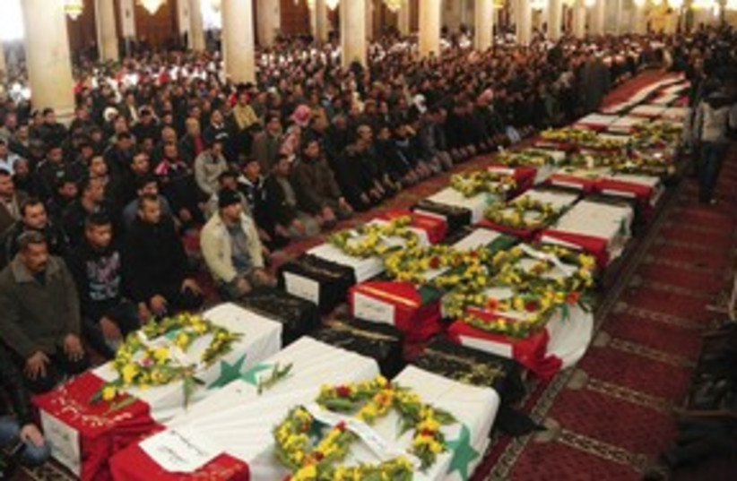 Syrians pray next to coffins 311  (photo credit:  REUTERS/Sana Sana)