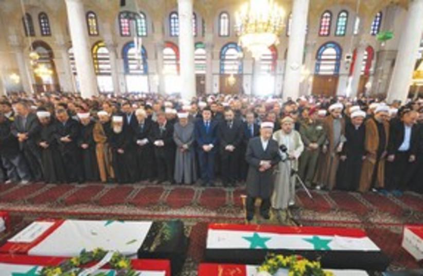 Syria funeral 311 (photo credit: SANA/Reuters)