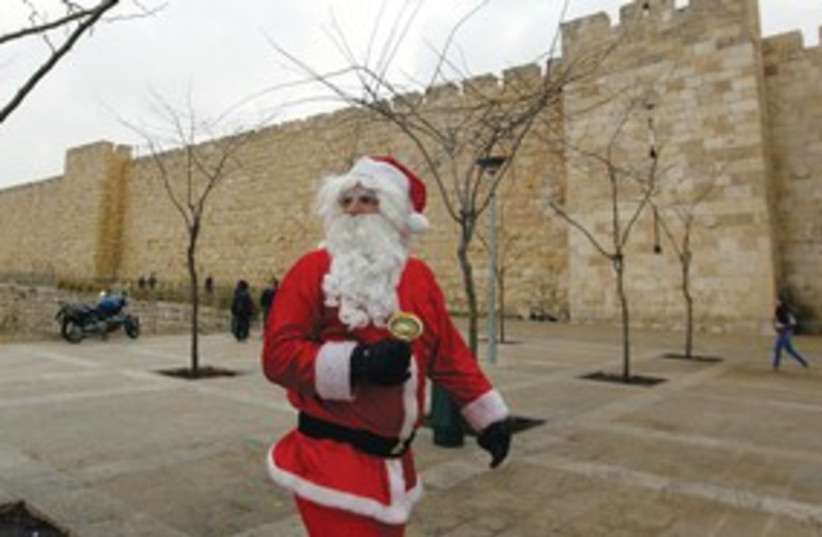 Santa Clause in Jerusalem (photo credit: (Ammar Awad/Reuters))