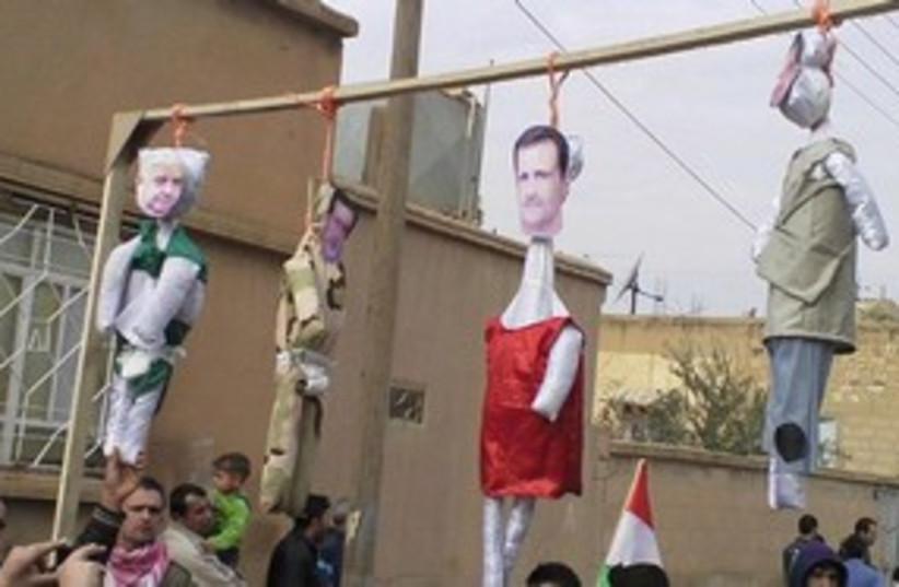 Assad hung in effigy 311 (photo credit: Reuters)