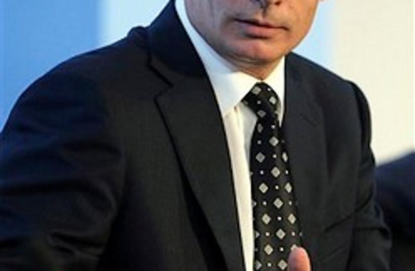 Russia's Prime Minister Vladimir Putin speaks at an international investment forum in the Black Sea resort of Sochi (photo credit: AP)