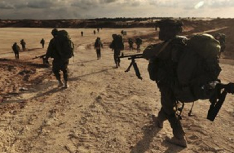IDF soldiers walking to Gaza during Operation Cast Lead 311R (photo credit: Ho New / Reuters)