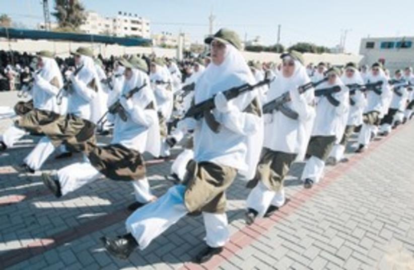 Female Hamas security forces graduation 311 (R) (photo credit: Ismail Zaydah/Reuters)