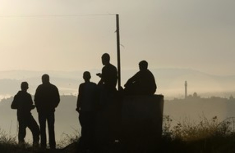 Settlers gather for prayer in Ramat Gilad_311 (photo credit: REUTERS/Ronen Zvulun)