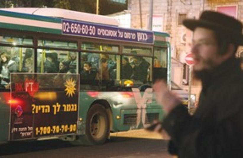Haredi man near a bus 311 (photo credit: (Marc Israel Sellem/The Jerusalem Post))