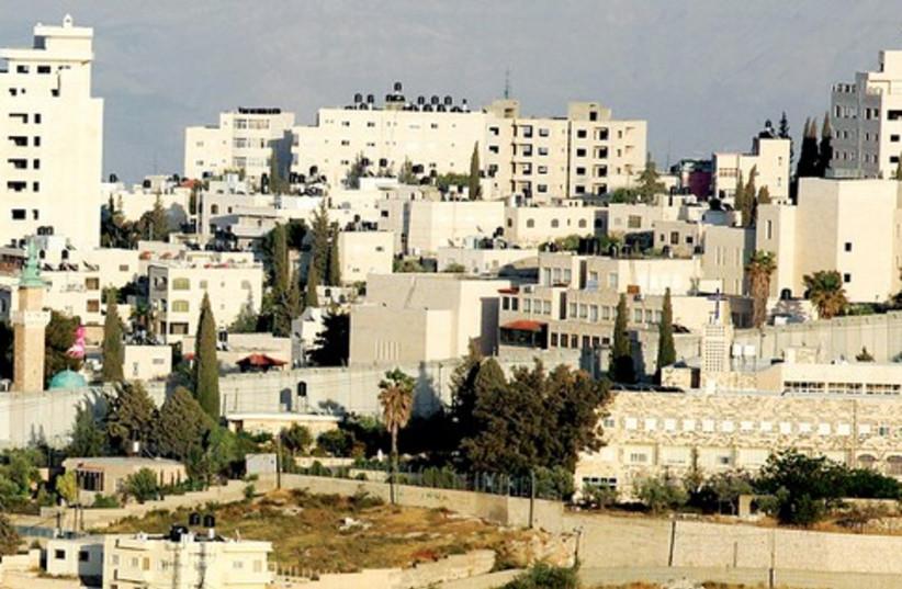 Abu Dis, Jerusalem, security barrier_521 (photo credit: Marc Israel Sellem)