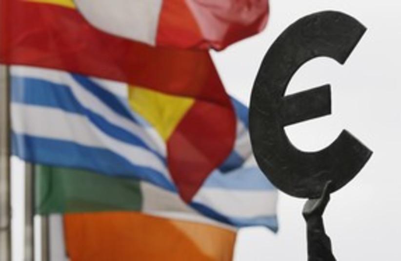 Euro symbol near European flags 311 (photo credit: REUTERS/Francois Lenoir)