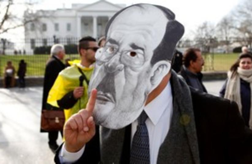 protester mask iraq Nouri al-Maliki (photo credit: REUTERS/Kevin Lamarque )