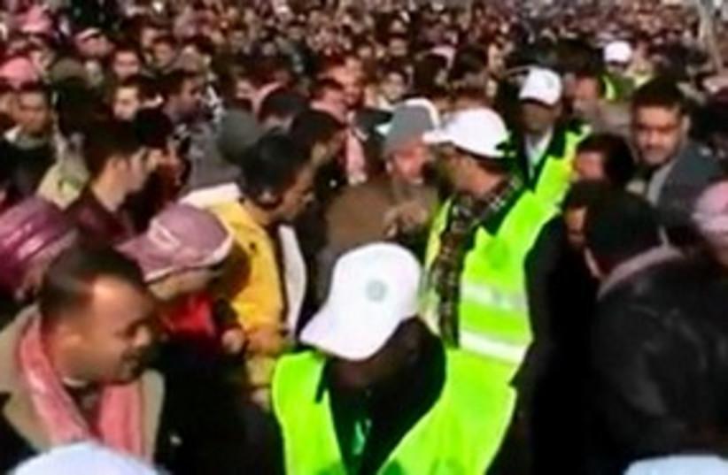 Arab League observers walking through protest (photo credit: REUTERS/via Reuters Tv/Handout )