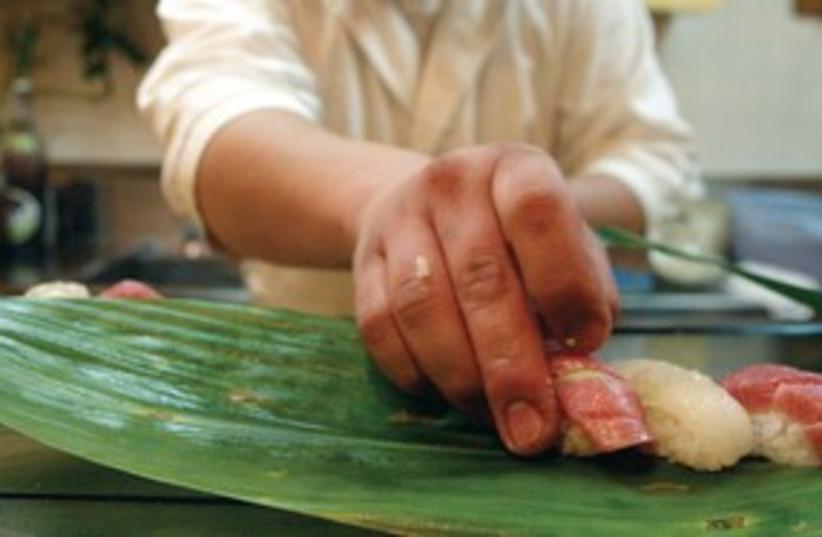 sushi chef prepares sushi_311 (photo credit: Reuters)