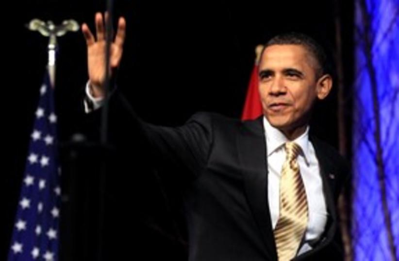 US President Barack Obama smile 311 (R) (photo credit: REUTERS/Kevin Lamarque)
