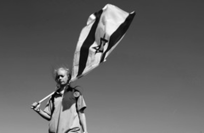 Jewish girl with Israeli flag (black and white) 311 (photo credit: (Ariel Jerozolimski))