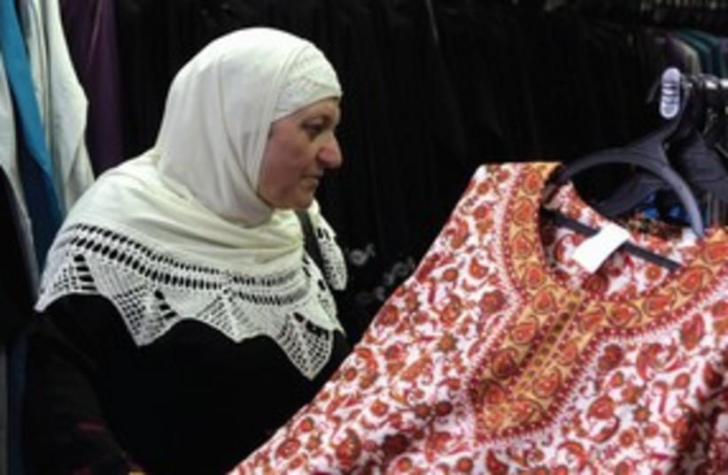 Palestinian Arab woman shopping store 311 (photo credit: Marc Israel Sellem)