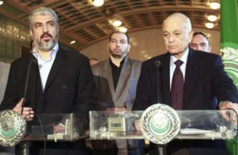 Hamas leader Mashaal (L), Arab League chief Elaraby (R)_311 (photo credit: Reuters)