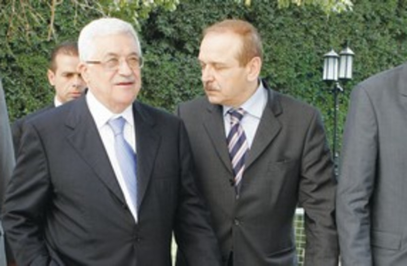 Mahmoud Abbas and Yasser Abed Rabbo 311 (R) (photo credit: Nasser Nuri/Reuters)