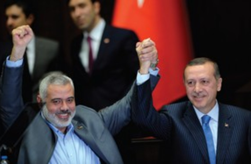 PRIME MINISTER Erdogan and Hamas leader Haniyeh 311 (photo credit: Reuters)