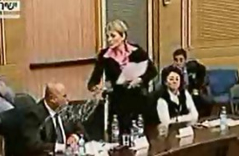 Michalei throws water at Majadele 311 (photo credit: Knesset Channel)