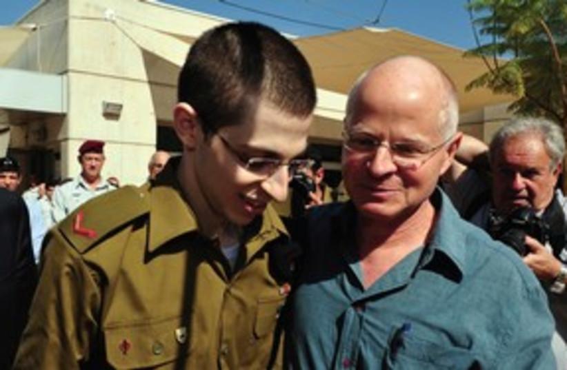 Gilad and Noam Schalit reuniting 311 (R) (photo credit: Reuters))