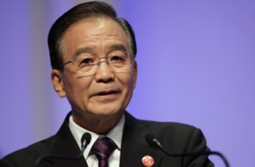 China's Premier Wen Jiabao delivers a speech 311 (R) (photo credit: 	 REUTERS/Jason Lee)