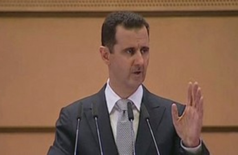 Assad making speech 311 (r) (photo credit: REUTERS/Syrian TV)