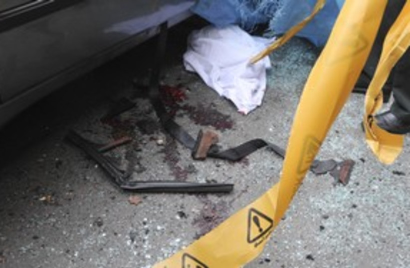 Bloodstains next to car belonging to Iranian scientist  311 (photo credit: REUTERS/Stringer Iran)