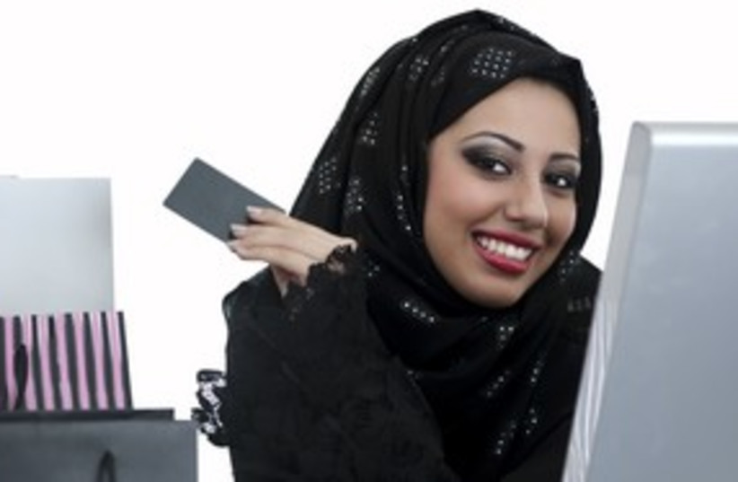 Arab woman credit card shopping_311 (photo credit: Thinkstock/Imagebank)