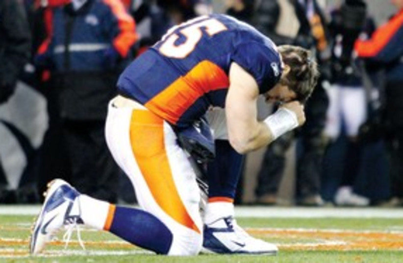 Tim Tebow 311 (photo credit: REUTERS)