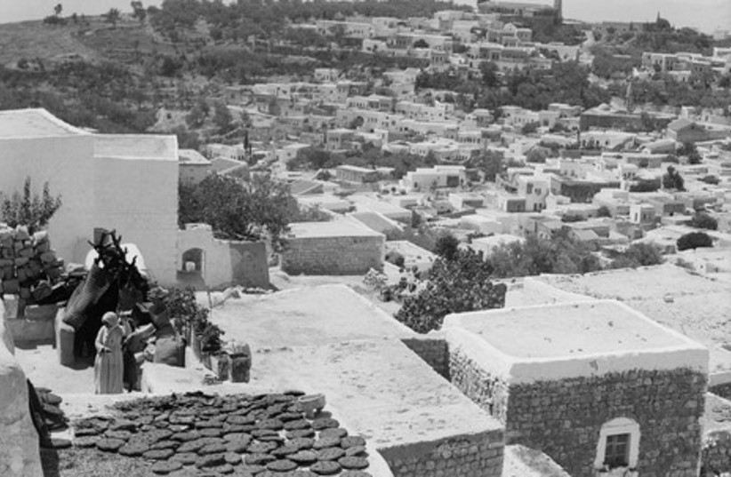 Safed's flat roofs are covered with drying wheat.