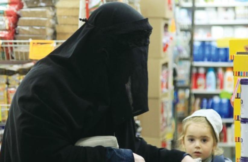 Haredi woman in a 'burka' 521 (photo credit: Marc Israel Sellem)
