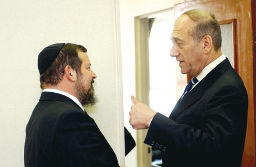 Ehud Olmert (right) and Uri Lupolianski. 521 (photo credit: Ariel Jerozolimski)