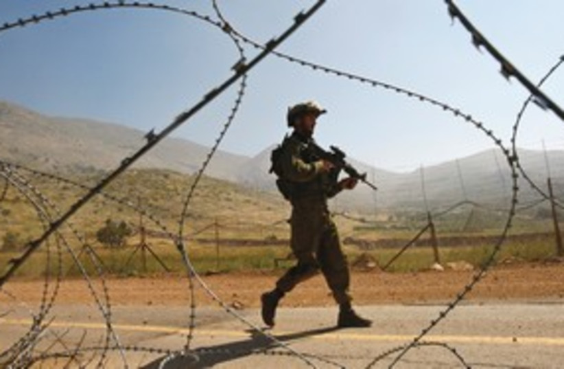 IDF soldeirs patrols Syrian border 311 R (photo credit: Ronen Zvulun / Reuters)