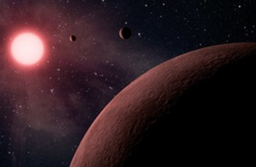 Artist's rendition of exoplanets 311 (photo credit: Astrophysical Journal)
