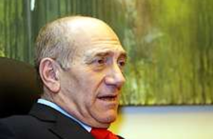 Olmert sits back 224.88 (photo credit: Ariel Jerozolimski)
