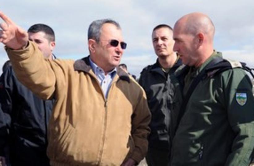 Defense minister Ehud Barak pointing 311 (photo credit: Ariel Harmoni/Defense Ministry)