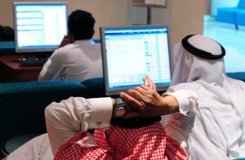 Saudi traders stocks 311 (photo credit: STR New / Reuters)