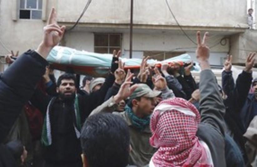 Syrian protestors at a funeral 311 (photo credit: Reuters)