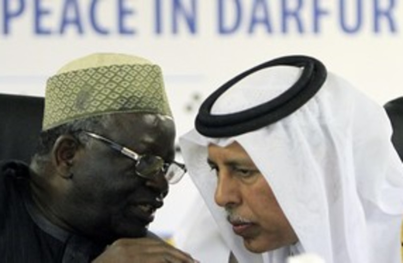 Ibrahim Gambari and Qatars Ahmed Mahmoud  311 R (photo credit: Mohamed Nureldin Abdallah / Reuters)