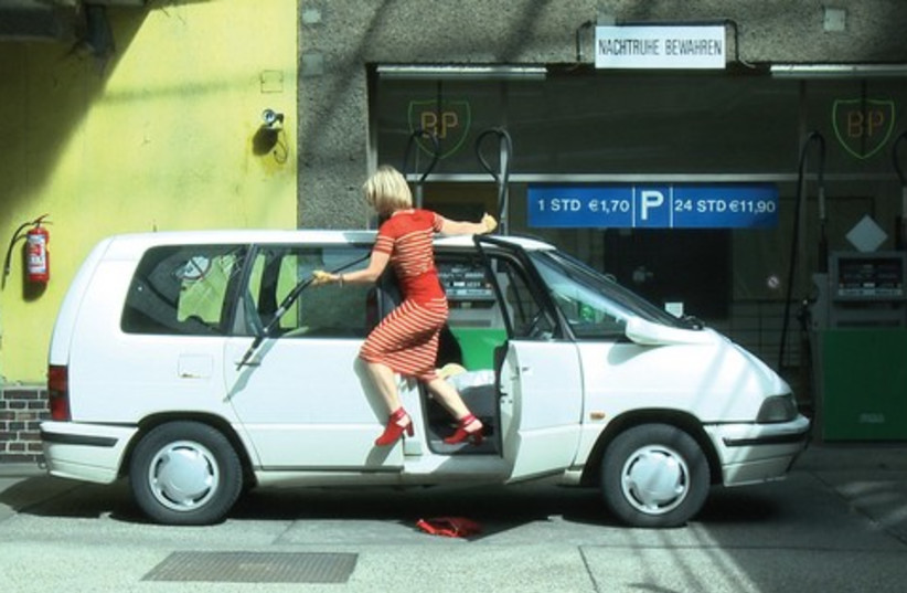 Dertnig poses as a 'dumb blonde' (photo credit: Courtesy)
