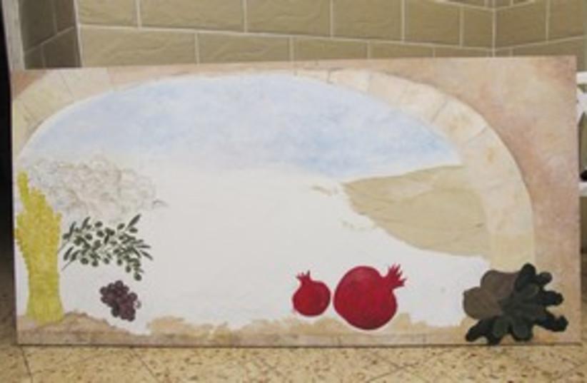 Nahalot mothers work on Seven Species mural 311 (photo credit: Melanie Lidman)
